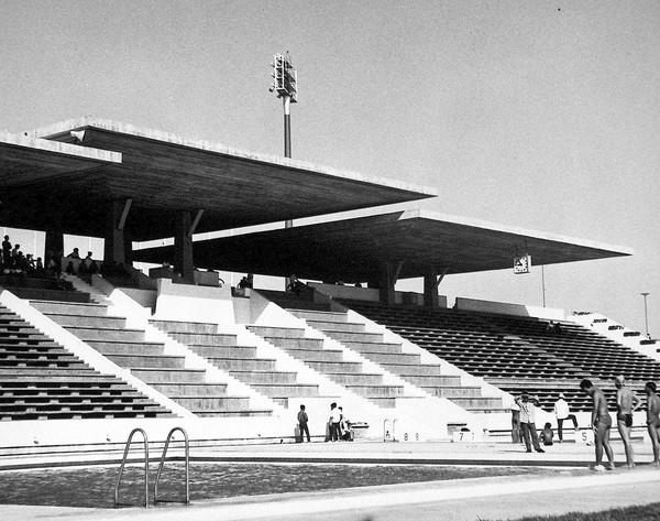 The swimming pool at Olympic Stadium in Phnom Penh, completed in 1964. The large concrete overhangs protect spectators from the sun.