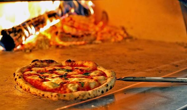 The pizza margherita is seriously good, baked in a wood-burning oven.