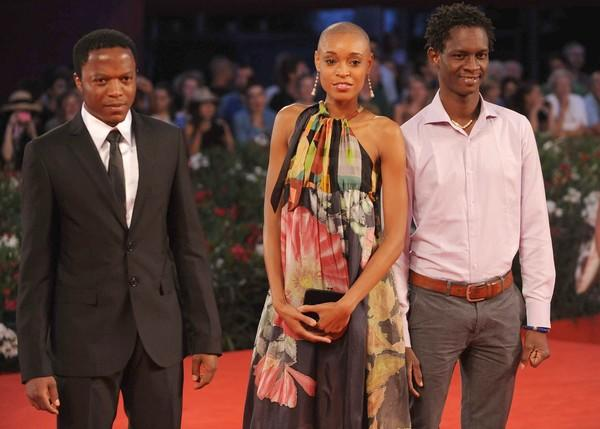 "Actor Blaise Essoua, actress Irima Pino Viney and a guest arrive for the screening of ""Il Villagio di Cartone."""