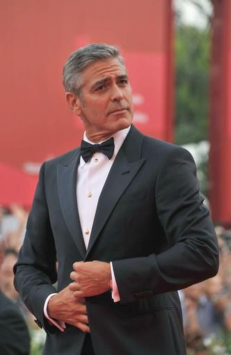 "A dapper George Clooney hits the red carpet for the premiere of ""The Ides of March,"" the political drama he co-wrote, directed and stars in."