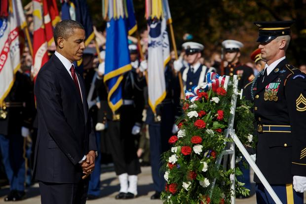 President Obama participates in the presidential wreath-laying ceremony at the Tomb of the Unknowns at Arlington National Cemetery.