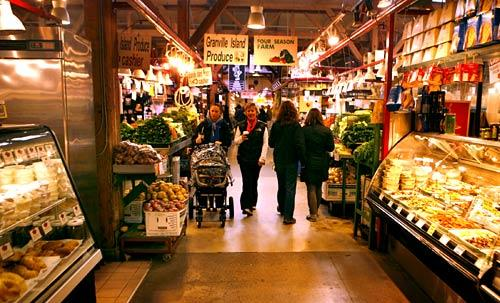 Shoppers stroll through Vancouver's Granville Island Public Market, a prodigiously polyglot and blissfully chain-free food court.