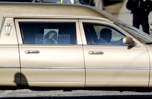 "The hearse that carrying the body of singer Whitney Houston drives past the New Hope Baptist Church before Houston's funeral in Newark, N.J. Houston died Feb. 11 in Beverly Hills, where she had planned to attend a pre-Grammys event. <br><br> <a href=""http://www.latimes.com/entertainment/news/la-et-whitney-houston-sg,0,734105.storygallery"" target=""blank""><b>FULL COVERAGE: Whitney Houston 