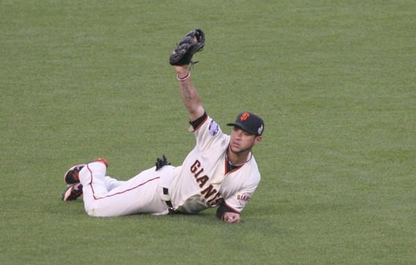 Giants center fielder Angel Pagan makes a diving catch of a ball hit by Tigers third baseman Miguel Cabrera in the third inning of Game 1 of the World Series on Wednesday night at AT&T Park.