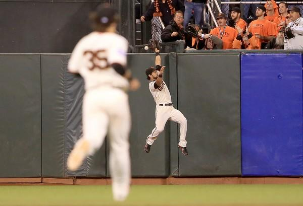 Giants center fielder Angel Pagan leaps against the wall but can't bring down a home run by Detroit's Jhonny Peralta in the ninth inning of Game 1 of the World Series on Wednesday night.