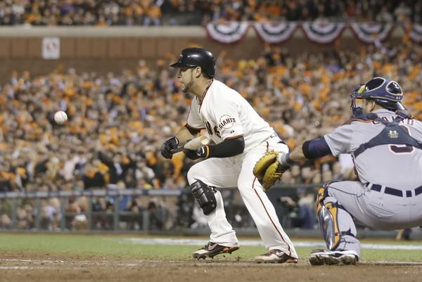 Giants left fielder Gregor Blanco bunts down the third-base line for a single to load the bases in the seventh inning of Game 2 of the World Series on Thursday night at AT&T Park.