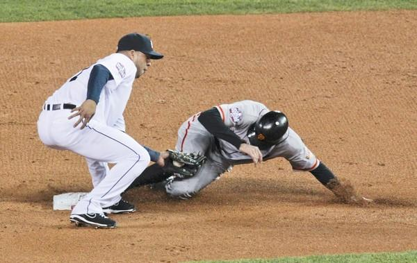 Giants right fielder Hunter Pence beats the tag of Tigers shortstop Jhonny Peralta to steal second base in the second inning of Game 3 of the World Series on Satuday night in Detroit.