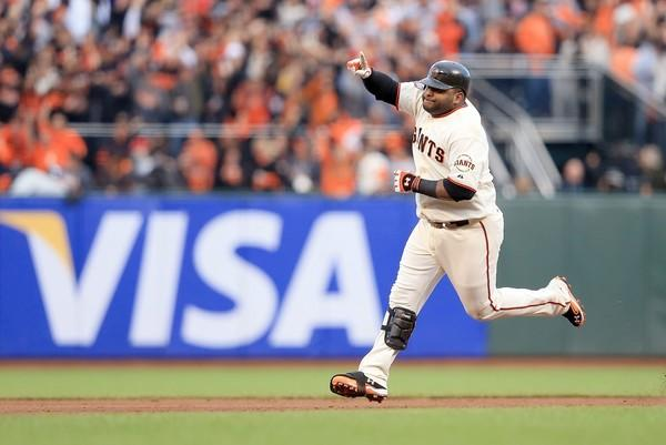 Giants third baseman Pablo Sandoval rounds the bases after hitting a solo home run against the Tigers in the first inning of Game 1 of the World Series on Wednesday evening at AT&T Park in San Francisco.