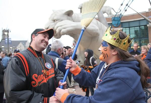 Giants fan Brian Gomez has his broom wrestled away by Tigers fan Danielle Pizzo before Game 4 of the World Series on Sunday night in Detroit.