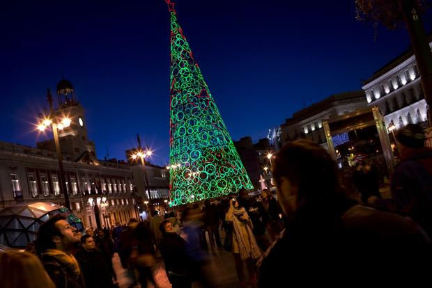 A metal Christmas tree decorates Madrid's Puerta del Sol square.