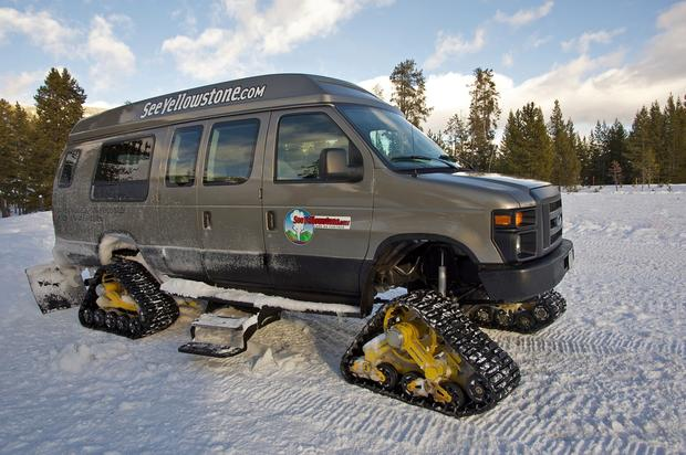 Snowcoaches are a popular mode of transportation during the winter in Yellowstone.