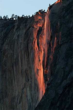 Horsetail Falls may look as though it's on fire, but it's actually the setting sun casting a reddish hue.