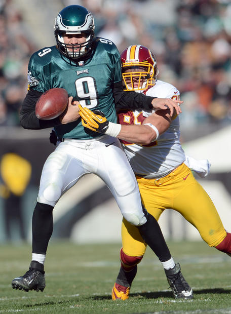 Philadelphia Eagles quarterback Nick Foles (9) fumbles as he is hit by Washington Redskins outside linebacker Ryan Kerrigan (91) at Lincoln Financial Field in Philadelphia on Sunday.