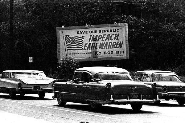 "Earl Warren, 14th chief justice of the U.S. Supreme Court, brought the deeply divided court to a unanimous decision with the 1954 ruling on Brown vs. Board of Education. The ruling overturned the 1896 ""separate but equal"" decision and banned segregated schools.  Throughout the South, billboards were erected: ""Impeach Earl Warren."""