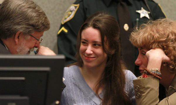 Casey Anthony clowns around talking with defense counsel Cheney Mason and Dorothy Clay Sims, before her sentencing hearing at the Orange County Courthouse, in Orlando, Fla., Thursday, July 7, 2011.