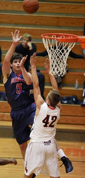 Lake Brantley's Brendon Mooney (5) shoots over Winter Park's Nils Lehman (42) during the game of Winter Park High versus Lake Brantley High at the Rotary Tip-Off Classic basketball tournament at Winter Park High School on Thursday, November 29, 2012.