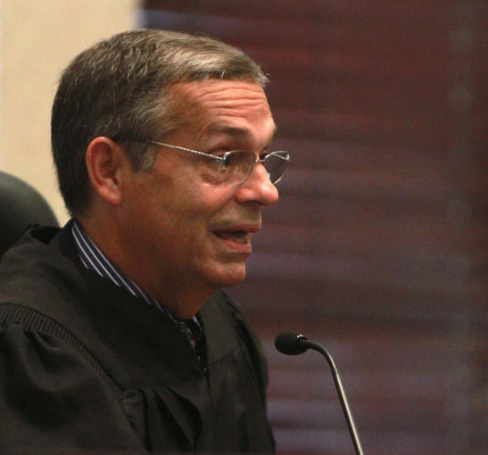 Ninth Circuit Court of Florida Judge Jose R. Rodriguez addresses Casey Anthony's civil attorney Charles Greene, during a hearing in Zenaida Gonzalez ' civil suit against Anthony, at the Orange County Courthouse in Orlando, Fla., Friday. Rodriguez later announced he was removing himself from the case.