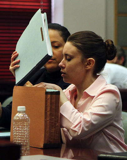 Casey Anthony,right, places documents in a folder as co-counsel Michelle Medina watches at the close of a pre-trial hearing Wednesday, March 23, 2011at Orange County courthouse. Casey Anthony, 25, is accused of killing her 2-year-old daughter Caylee Marie Anthony in the summer of 2008.