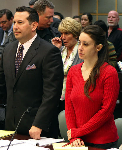 Attorney Jose Baez, left, and his client Casey Anthony, 24, right stand as Cindy Anthony ,center, is called to the witness stand March 2, 2011 during a two-day hearing which began today on a series of motions by the defense and the prosecution in the Casey Anthony murder trial, with both sides seeking to control — and tailor — the information considered by the 12 people who will ultimately decide her fate.