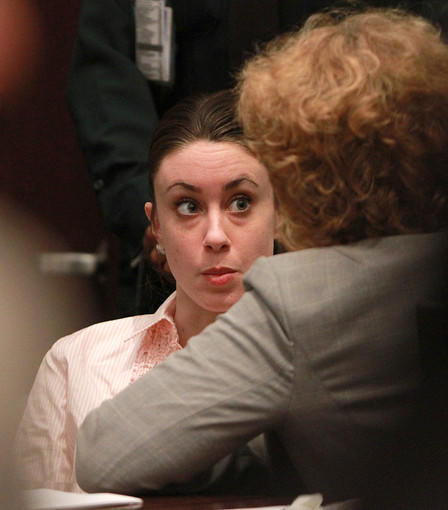 Casey Anthony talks in the courtroom with her attorney Dorothy Clay Sims at the start of the second day of jury deliberations in her murder trial at the Orange County Courthouse Orlando, Fla. on July 5, 2011.