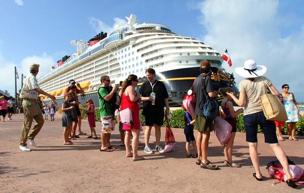 Guests debark the Disney Dream onto Castaway Cay, Bahamas, on the official christening cruise of the ship, from Port Canaveral, Fla., to Castaway Cay, Bahamas, Thursday, Jan. 20, 2011.