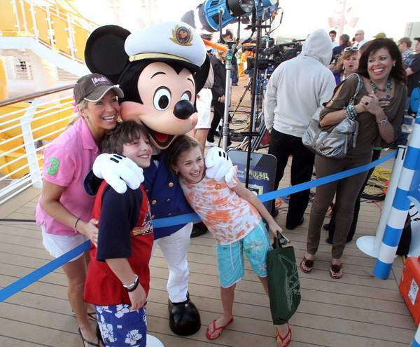 Mickey hugs (from left) Stefani Schaefer, of Cleveland, Ohio, and her children, Race, 10, and Siena, 8, during the official christening cruise of the Disney Dream, from Port Canaveral, Fla., headed to the Bahamas, Wednesday, Jan. 19, 2011.