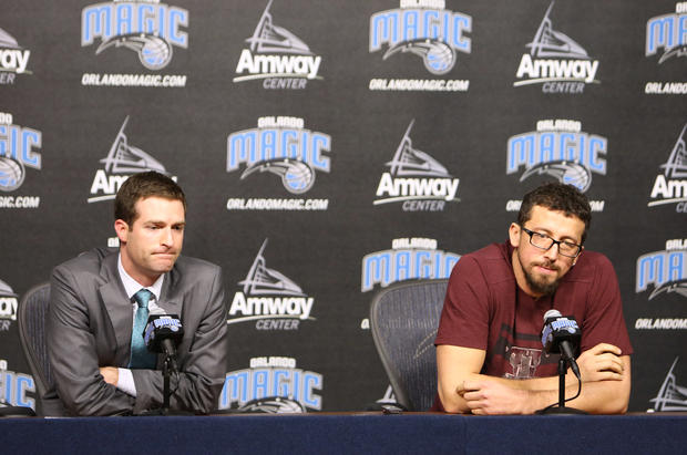 Orlando Magic General Manager Rob Hennigan and forward Hedo Turkoglu answer questions during a press conference at Amway Center after the NBA announced Turkoglu's 20 game suspension for violating the terms of the NBA/NBPA Anti-Drug Program by testing positive for methenolone in Orlando