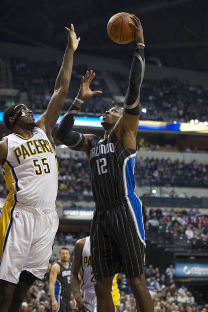 Orlando Magic center Dwight Howard (12) scores a basket over top of Indiana Pacers center Roy Hibbert (55) during the first half at Bankers Life Field House.