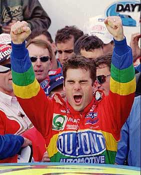 Jeff Gordon celebrates as he gets out of his Chevrolet in Victory Lane after winning the Daytona 500.