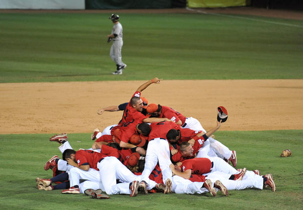 Stony Brook Seawolves players celebrate their 10-6 win over the UCF Knights in game seven of the Coral Gables regional at Alex Rodriguez Stadium.
