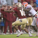 Florida defensive end Jermaine Cunningham (49) pressures Florida State quarterback D'Vontrey Richardson (10)