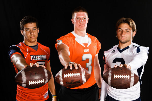 Derik Abbot of Freedom, Alton Meeks of Boone, and Nick Patti of Dr. Phillips High School pose for a portrait during Varsity Media Day at the Orlando Sentinel on Saturday, August 20, 2011.