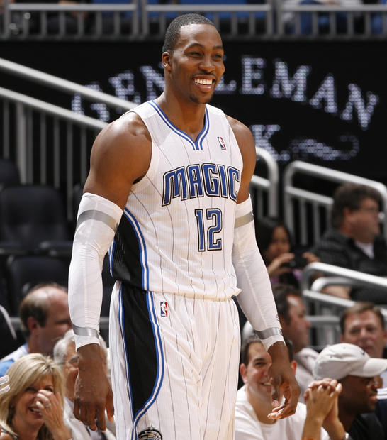 Orlando center Dwight Howard (12) smiles at the end of their 96-89 win over the Charlotte Bobcats in Orlando, Fla. Tuesday, January 17, 2012.