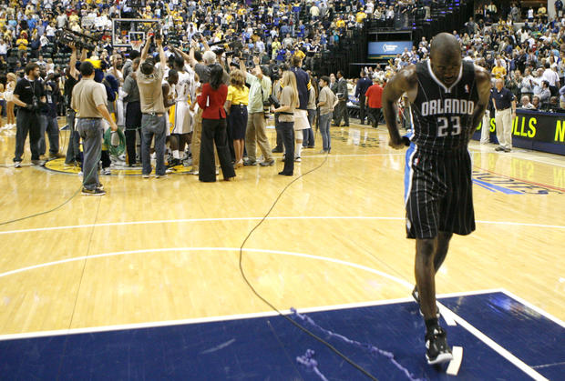 Orlando's Jason Richardson walks off the court as the Indiana Pacers celebrate after Game 5 between the Orlando Magic and the Indiana Pacers in the Eastern Conference quarterfinals of the 2012 NBA Playoffs Tuesday, May 8 at Bankers Life Fieldhouse in Indianapolis, Ind. The Pacers won 105-87 to advance to the second round of the playoffs.