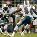 Miami running back Ricky Williams looks for room