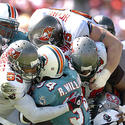 Dolphins running back Ricky Williams runs into a wall