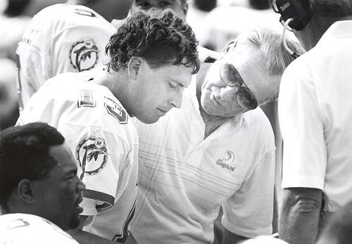 Dan Marino and Don Shula talk during a game.