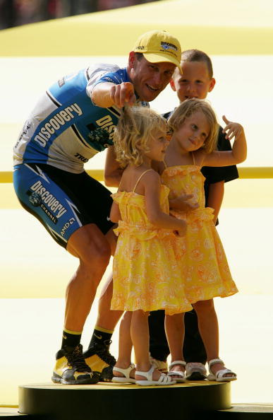 Lance Armstrong with his children Luke, Grace and Isabella on the podium after winning the Tour de France on July 24, 2005.