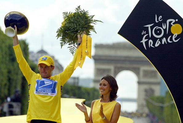 Lance Armstrong celebrates on the podium at the end of the 20th and last stage of the 90th Tour de France cycling race on July 27, 2003.
