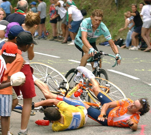 Lance Armstrong and Spaniard Iban Mayo fall down at the end of the 15th stage of the 90th Tour de France on July 21, 2003. Armstrong won the stage.