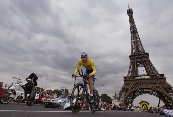 Lance Armstrong rides in front of the Eiffel Tower during the prologue of the 90th Tour de France on July 5, 2003.