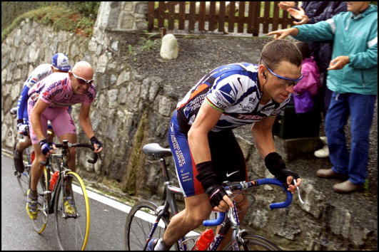 Lance Armstrong and Marco Pantani ride in the 10th stage of the 2000 Tour de France.