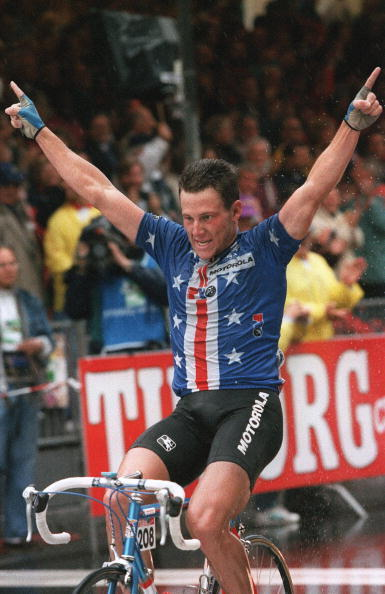 American Lance Armstrong celebrates as he crosses the finish line to win the individual road race at the World Cycling Championships on August 29, 1993.