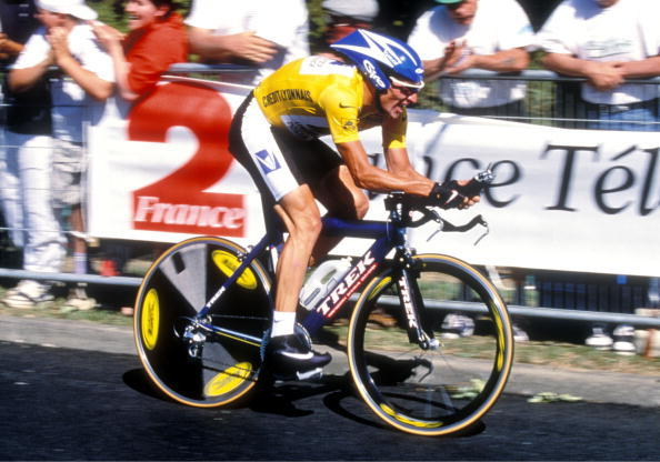 Lance Armstrong rides to his third Tour de France victory in Paris in July 1999.