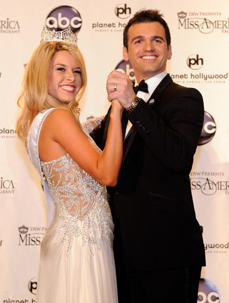 Dancer Tony Dovolani (L) poses with Teresa Scanlan, Miss Nebraska, at a news conference after she was crowned the new Miss America during the 2011 Miss America Pageant at the Planet Hollywood Resort & Casino January 15, 2011 in Las Vegas, Nevada. Dovolani served as one of the judges for the pageant.