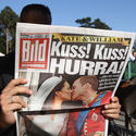 A man reads a German newspaper featuring coverage of the royal wedding on April 30, 2011 in Bad Saarow, Germany.