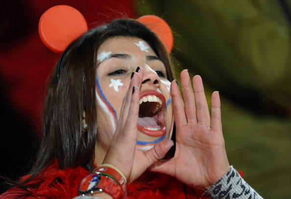 A supporter of Chile cheers. (VINCENZO PINTO/AFP/Getty Images)