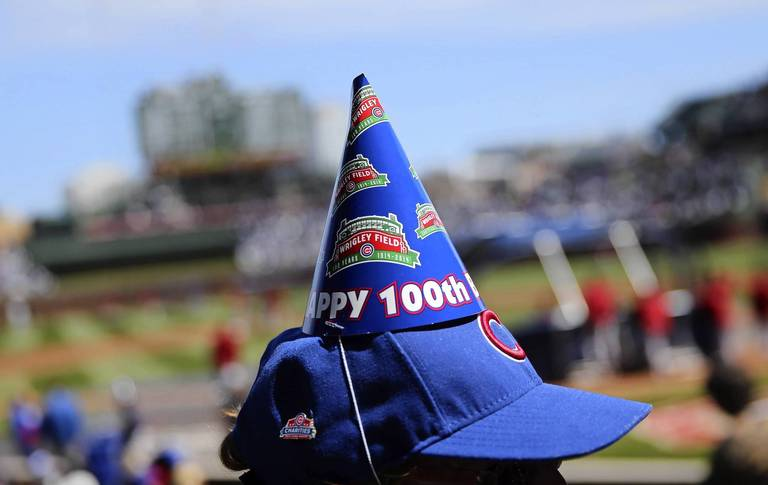An Usher Wears A Birthday Hat On Wrigley Fields 100th Anniversary