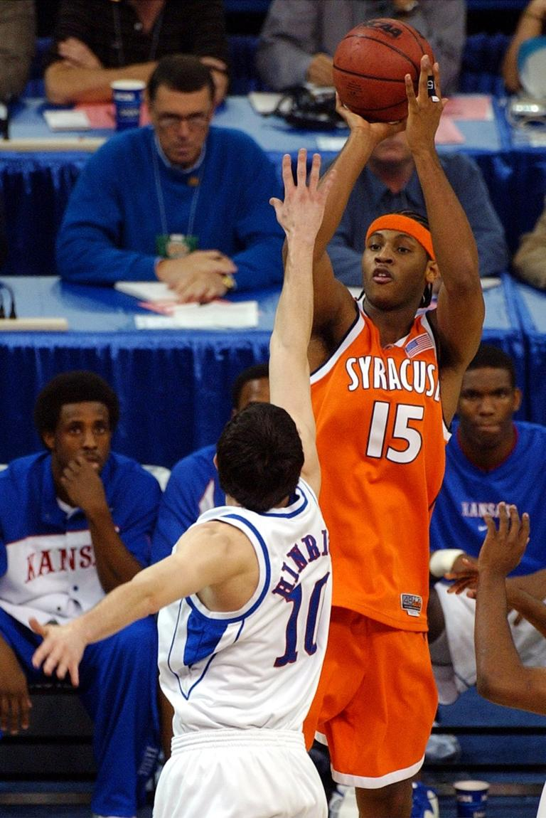 96b5ed3f94f2ec Syracuse s Carmelo Anthony shoots over Kansas  Kirk Hinrich during first  half action of the NCAA