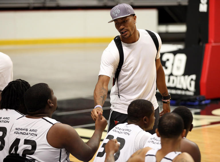 Derrick Rose greets players before a Noah s Arc Foundation One City  basketball tournament organized by Joakim 983a12598